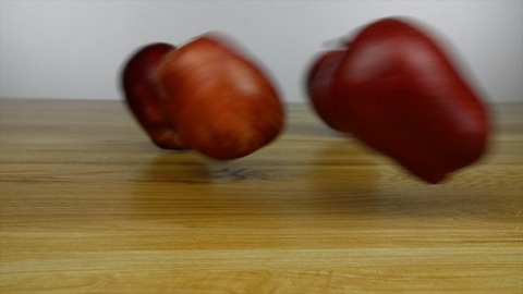 Fresh, juicy and nutritional apples rolling over a kitchen table - healthy fruit diet