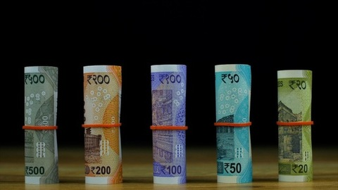 Racking focus shot of different and new Indian paper currency - black background
