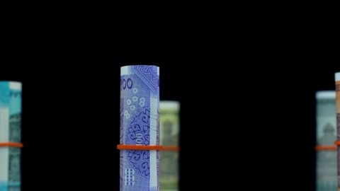 Closeup shot of various bundles of Indian currency notes on black background