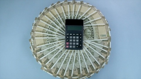 Top view shot of a calculator and five hundred rupees notes - accounting concept