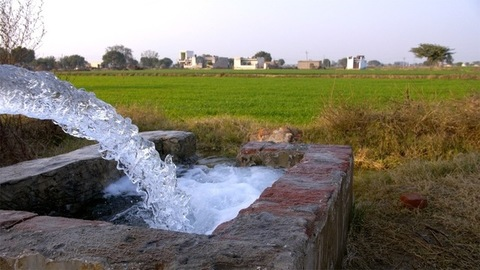 Fresh and pure water coming out of an agricultural tube well for irrigation