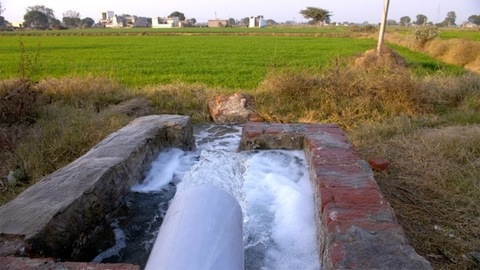Close up shot of a diesel water pump helping Indian villagers to irrigate fields