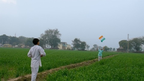 Two little boys having fun in kite flying on the Independence / Republic day in India