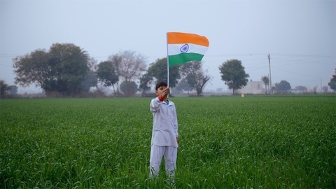 Young village boy hosting the Indian national flag on Independence / Republic day