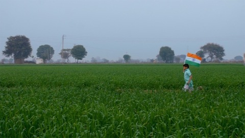 Young village kid rejoicing on the occasion of Independence / Republic day in India