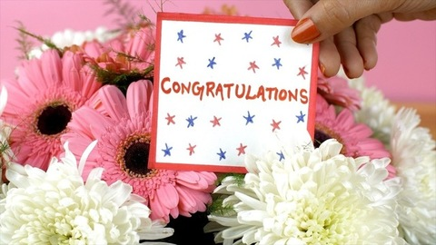 A congratulations message card with a beautiful bouquet of pink and white flowers