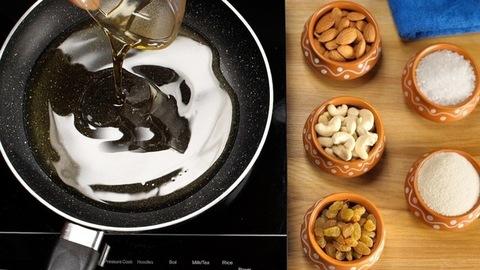 Woman putting a bowl of homemade golden clarified butter/Ghee in a frying pan