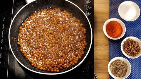 Small black Chana Sabzi/curry boiling in a non-stick pan - popular Indian recipe