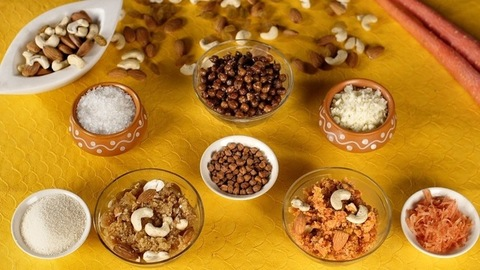 Famous Indian spicy and sweet dishes kept together with their raw ingredients