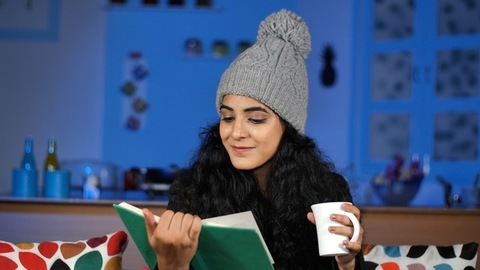 Lovely teenager relaxing at home in India during winter - leisure time