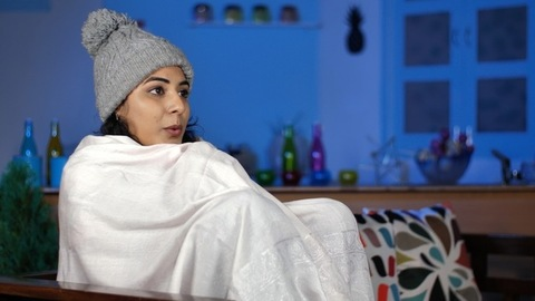 Indian lady wearing a gray woolen cap feeling cold - white shawl to keep herself warm