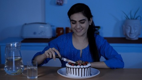 Happy pretty teenager celebrating her birthday alone at night - new normal concept