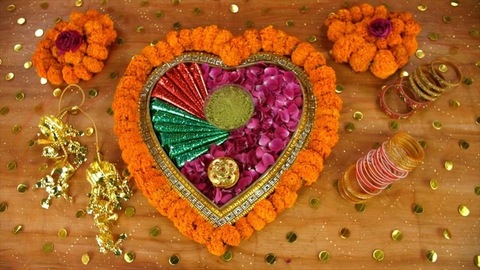 Zoom out shot of a decorated surface with wedding items - Indian wedding concept