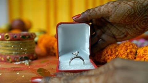 Closeup shot of mehndi on woman hands showing her beautiful wedding ring