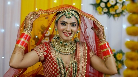 Beautiful Indian bride wearing red Lehenga with Chuda for her wedding