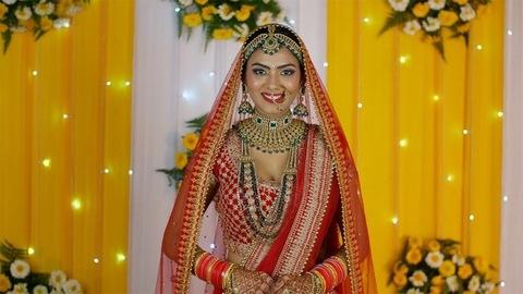 Portrait of a beautiful Indian bride wearing a red lehenga on her wedding