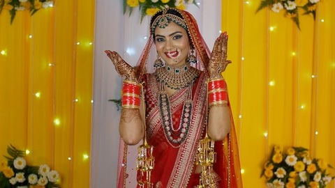 Beautiful north Indian bride in a red wedding dress - Mehendi decorated hands