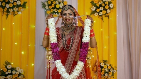 Beautiful bride holding red and white wedding garland - Indian marriage rituals