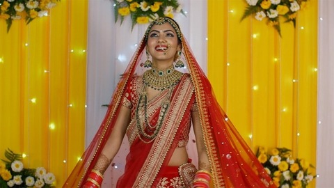 Young and happy Indian bride on decorated stage - Indian marriage