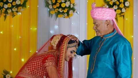 Pretty daughter taking her father's blessings on her marriage ceremony - Indian wedding