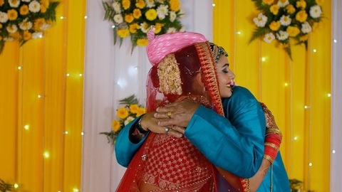 Young Indian bride lovingly hugs her father on her wedding day - Hindu wedding