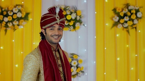 Cheerful Indian man happily looking towards the camera on his marriage day