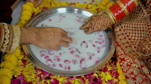 Closeup shot of bride and groom's playing games during a post-marriage ritual