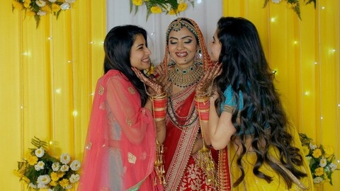 Sisters/friends enjoying with a north Indian bride on a floral decorated stage