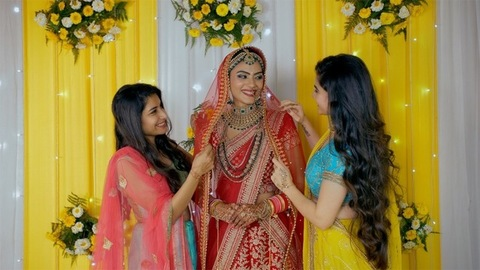 Indian bride in a wedding dress with her sister and friend - Happy and smiling