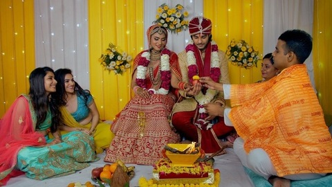 Punjabi bride and groom performing traditional marriage customs - Indian wedding