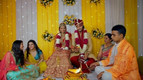 Hindu priest / Pandit performing marriage rituals of a north Indian couple