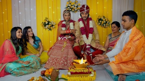 Traditional Indian wedding - Bride and Groom with friends at the marriage ceremony
