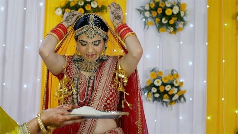 Beautiful Indian bride performing wedding rituals wearing a traditional lehenga