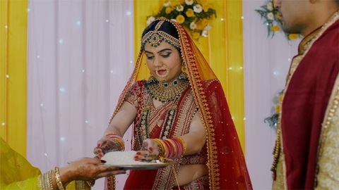Beautiful bride performing the Vidai/Bidai/Bidaai ritual in a traditional lehenga