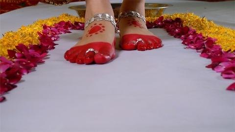 Closeup shot - Indian bride's footprints. Indian marriage tradition during Griha Pravesha