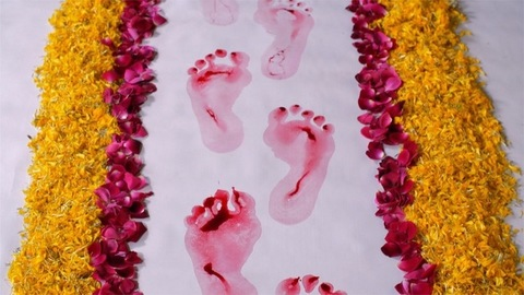 A newly married woman's red footsteps symbolic to the arrival of Goddess Lakshmi