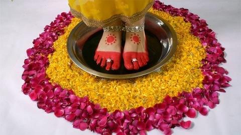 Closeup shot a beautiful Indian bride's performing Griha Pravesha rituals