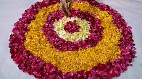 Indian female's hand making rangoli on the floor for Diwali/Dipavali festival
