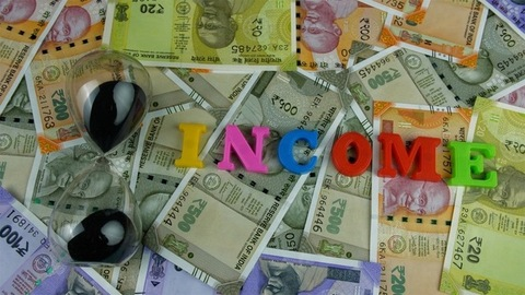 """Moving shot of plastic letters forming the word """"Income"""" - business/finance concept"""