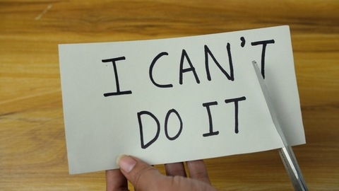 """Closeup of woman hands changing the text from """"I can't do it"""" to """"I can do it"""""""