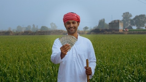 The middle-aged Indian farmer is smiling while showing his monthly income