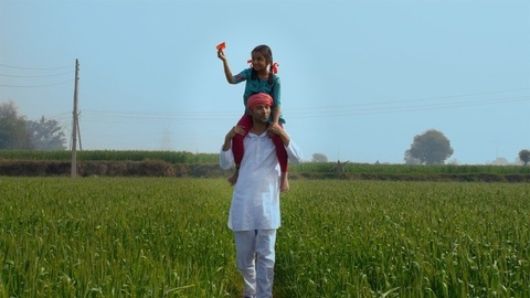 A father-daughter duo enjoying their simple happy life roaming in their farmland