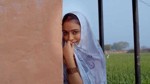 Young beautiful lady smiling while looking into the camera - traditional clothing