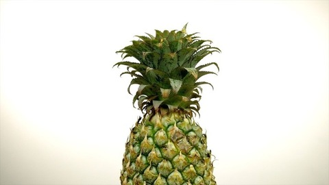 Single whole pineapple isolated aganist a white background - healthy fruit