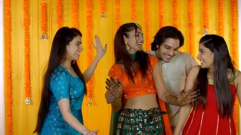 Indian wedding - Would-be husband-wife dancing with friends on their Sangeet ceremony
