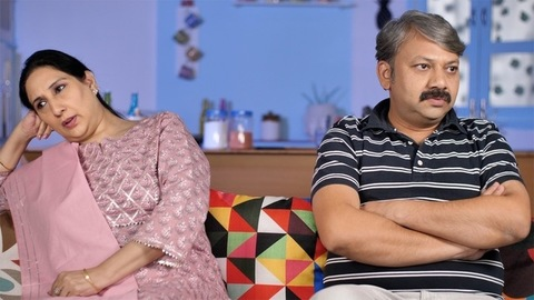 Irritated aged couple quarreling with each other at home - family problems