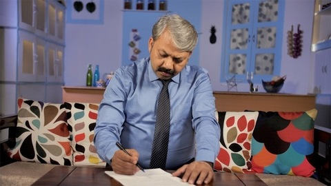 An Indian businessman wearing formals reading an important official document
