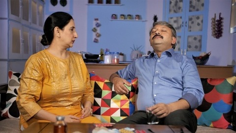Loving wife giving medicine to her unwell husband - health and medical