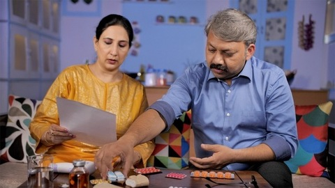 Mature couple checking and matching medicines with the doctor's prescription