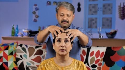 Matured Indian male giving a head massage to his wife - Happy Indian couple